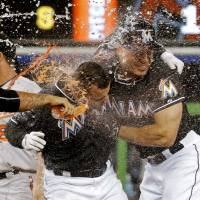 Jennings gets first victory as Marlins snap skid