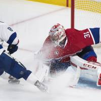 Lightning top Habs in 2OT on disputed play