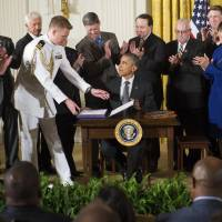 Obama inks 'fast-track' trade bills but says tough talks lie ahead before TPP is reality