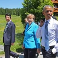 Obama's trade quest in Congress trails him to German G-7 summit