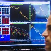 Greek default fears send Dow plunging; volatility spikes