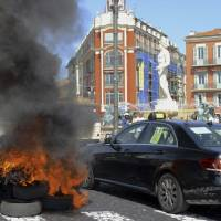 UberPop must be closed down, vehicles seized, French interior minister says amid taxi clash