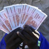 Count the zeroes: Zimbabwe allows old bank note exchange