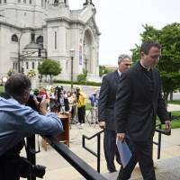 U.S. archdiocese indicted over sex-abuse coverup; archbishop quits; Vatican charges envoy