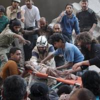 Syrian barrel bomb raid believed killed dozens of civilians; U.N. slams attack, ups toll