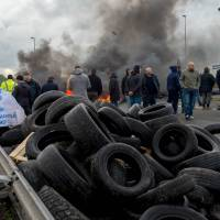 Calais chaos as strike halts English Channel trains, ferries; migrants stow away