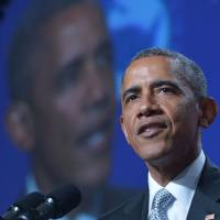 Obama says church shooting exposes 'blight' of racism, need for gun laws