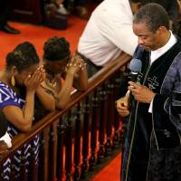Gospel, prayer as resilient Charleston church sways in first service since massacre