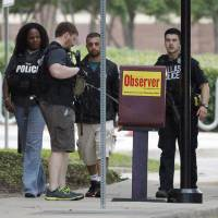 Suspected bombers open fire on officers outside Dallas police HQ