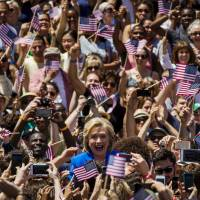 Clinton courts working Americans at first major presidential campaign rally