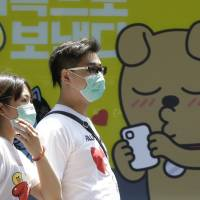 South Korea reports third MERS death as alarm grows