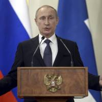 Putin wary of West's nearby missile defenses, threatens to aim forces at aggressors