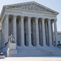 U.S. Supreme Court blocks Texas abortion rules that would force 10 clinic closures, for now