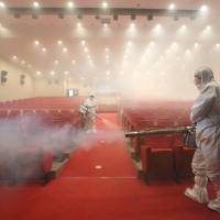 WHO lauds South Korean measures against MERS but is cautious after 14th death