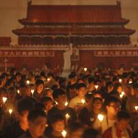 Tiananmen massacre victims commemorated by tens of thousands in H.K. but key youth figures absent