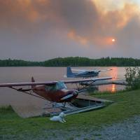Households flee as Alaska wildfire mushrooms in heart of sled dog country