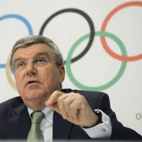 IOC approves new events for 2020 Tokyo Games; stadium delays worry Bach; baseball may make comeback
