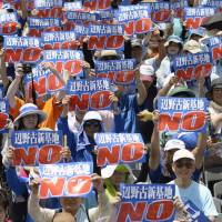 Okinawa's battle with bases, inequality played out by political pair