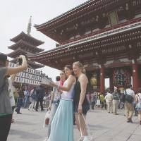 Tourism boom lifts economy, but brings headaches