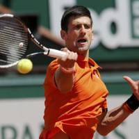 Djokovic outlasts Murray in two-day, French Open semifinal match