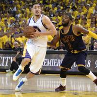 Warriors get by Cavaliers in OT thriller