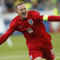 Rooney lifts England to win over Slovenia