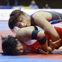 Yoshida, Icho book spots at wrestling worlds