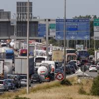 Protesting ferry workers block Calais port; Channel Tunnel closed