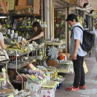 Spending slips as consumer prices inch up