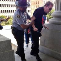 Black official seen helping man at KKK rally hopes photo will be 'catalyst' for change