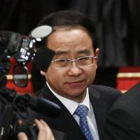 Top aide to former Chinese President Hu arrested, to face trial on corruption charges