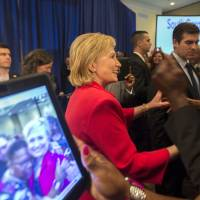 Clinton praises South Carolina for shedding rebel flag, urges bigger fight against racism