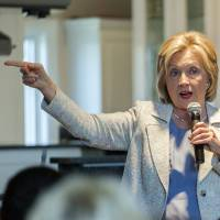 Clinton eyes comprehensive shift to wind, solar power