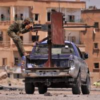 Regime troops, Kurds advance whittle down Islamic State's hold on Syria's Hasakeh