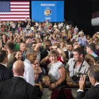 Obama, on Walker's turf, talks up unions, overtime pay, jabs GOP candidate scrum
