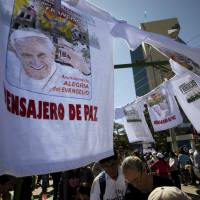 Pope taps Bolivia Burger King not for fast food but for fast change, then blasts consumersim