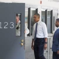 Another presidential first: Obama visits U.S. prison