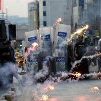 Turkish police use tear gas during protest over Islamic State blast in Kurd border town