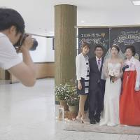 Some South Koreans defy tradition with simple, cheap weddings