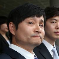 Gay couple become first to sue for marriage recognition in South Korea