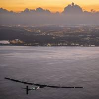 Solar Impulse touches down after record-breaking journey from Nagoya