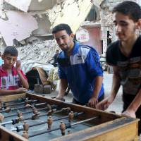 Syria regime hits Islamic State-held town with 'container bombs'; 23 killed