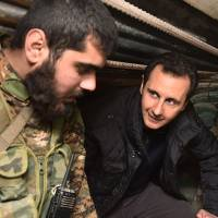 Syrian Islamists, courting West, say they will protect minorities