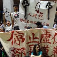 Taiwan students storm ministry amid furor over 'pro-China' textbooks
