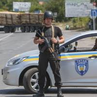 Ukraine far-right group demands minister's ouster after deadly shootout