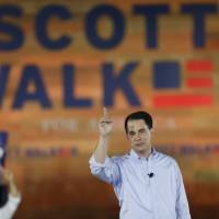 Wisconsin Gov. Walker, boasting union clashes, joins crowded Republican field