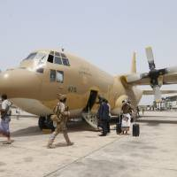 Yemeni troops fight Houthis in key town near Aden as truce looms