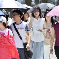 Four seniors die as Japan is hit by hottest day of summer
