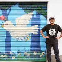Japanese artist first to paint peace mural at South Korean military facility