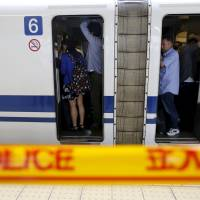 Japan's crowded, punctual rail network faces dilemma over security checks